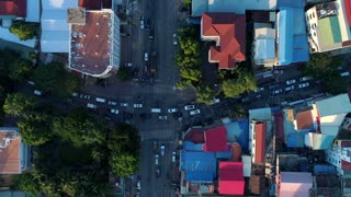Aerial Crazy Crowded Traffic Streets Phnom Penh Motorbike Vehicle Comunity City Cambodia Crime Human Trafficking Urban Capitol City Buddhism Tropical Palm Trees Flying Footage South East Asian 4K