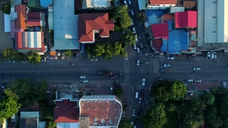 Aerial Crowded Streets Phnom Penh Motorbike Vehicle Comunity City Cambodia Crime Human Trafficking Urban Capitol City Buddhism Temple Pallace Tropical Palm Trees Flying View Footage South East Asian 4K