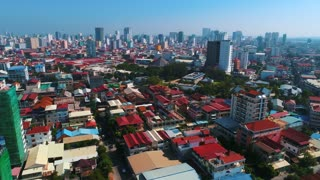 Aerial Establishing Phnom Penh Cambodia Crowded Streets Crime Human Trafficking Prostitute Urban Capitol City Buddhism Temple Pallace Tropical Palm Trees Flying View Footage South East Asian 4K