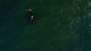 Aerial Fishing Boat Hauling In Net Sea Of Galilee Jesus Disciples Miracle Beach Ocean Pull Back Pan Up Establishing Drone Shot