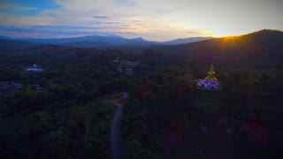 Aerial Giant Buddha Flyover Jungle Sunset Drone Laos Tourism Sunrise Tropical Palm Trees 4K