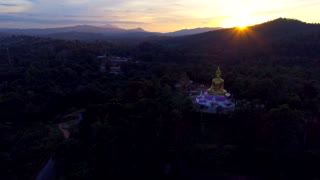 Aerial Giant Buddha Flyover Jungle Sunset Sun Rays Drone Laos Tourism Sunrise Tropical Palm Trees