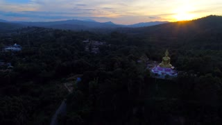 Aerial Giant Buddha Jungle Sunset Drone Laos Myanmar Burma Tourism Sunrise Tropical Palm Trees 4K