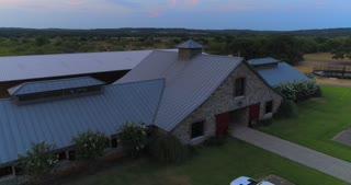 Aerial Horse Barn Texas Ranch Sunset Horses Paddock Field Drone 4K