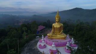 Aerial Huge Budda Drone Orbit Statue Towering Mountians Laos Thailand