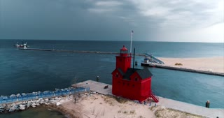 Aerial Lighthouse Storm Blowing In Holland Michigan Big Red Lighthouse Cinematic Drone