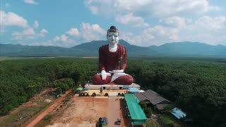 Aerial Massive Buddha Statue Asia Countryside Pull Back Drone