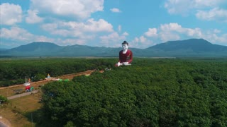 Incredible Massive Buddha Aerial Statue Asia Countryside Rubber Trees Orbit Drone
