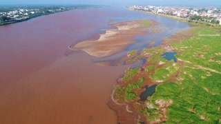 Aerial Mekong River Vientiane Laos Capitol Buddhism Temple Palace Tropical Palm Trees City Urban Flying View Drone Footage 4K