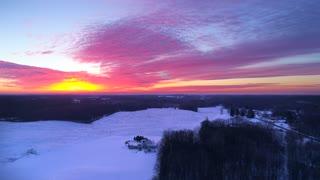 Aerial Michigan Landscape Winter Establishing Shot Farmers Fields To Urban Neighborhood Drone Backcountry Country Primitive Flying Snow Snowy Corn Field Sunset Wilderness 4K