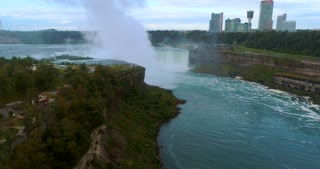 Aerial Niagara Horseshoe Falls Toronto Canada Skyline Flyover Cinematic Dramatic Toronto Canada Orbit Skyline Pre Dawn Waterfall Urban River Flight Mist Landmark Usa Tourist Destination