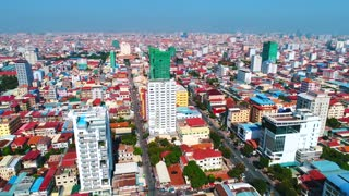 Aerial Phnom Penh Cambodia Crowded Streets City Urban Capitol Buddhism Temple Pallace Tropical Palm Trees Flying View Footage 4K
