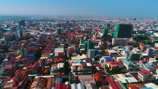 Aerial Phnom Penh Cambodia Crowded Streets Urban Capitol City Buddhism Temple Pallace Tropical Palm Trees Flying View Footage 4K