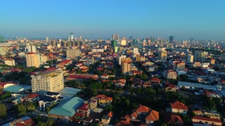 Aerial Phnom Penh Comunity Pan Down To City Cambodia Crowded Streets Crime Human Trafficking Prostitute Urban Capitol City Buddhism Temple Pallace Tropical Palm Trees Flying View Footage South East Asian 4K
