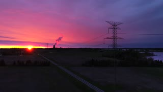Aerial Power Lines Flyover Nuclear Power Plant Sunrise Drone