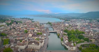 Aerial Push In Zurich Switzerland Establishing Shot Church Europe Water River Stream Statue Bridge Europe Steeple Walkway People Urban Architecture 4K Tourist Destination View Swiss Town