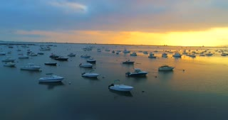 Aerial Sunrise Harbor Small Vessels Docked Plymouth Massachusetts 1620 Mayflower 2020 Drone Flyover Landmark Usa Tourist Destination 4K Nature Ocean Saltwater Beauty Boats Ship