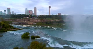 Aerial Toronto Canada Skyline Niagara Falls Flyover Cinematic Dramatic Toronto Canada Orbit Skyline Pre Dawn Waterfall Urban River Flight Mist Landmark Usa Tourist Destination