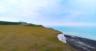 Aerial White Cliffs Flyover Ocean Old Hairy Rocks England Lighthouse Cinematic Drone