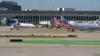 American Eagle Airlines Pulling Away From Gate Small Jet Tracking Shot Busy Airport Tarmac Airlines Pilots Taxying Through Shot Airplane Flying Away From Airport Travel Jumbo Boeing Commercial Aviation Jet Vacation