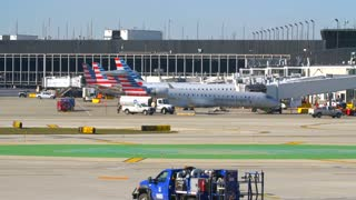 Americian Airlines Jet Taxying Through Shot Airplane Flying Away From Airport Travel Jumbo Boeing Commercial Aviation