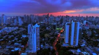 Bangkok Thailand Sunset Skyline Aerial Drone Pull Back Shot City Traffic Dusk