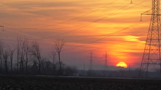 Beautiful Sunset Over Power Lines Electricity High Voltage Tension Electric Industry Field Authentic 4K