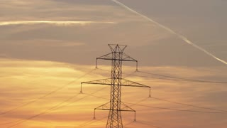 Beautiful Sunset Over Power Lines Electricity High Voltage Tension Sun Setting Electric Industry Field Authentic 4K