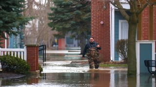 Flooded Apartments Relief Worker Aid To Natural Disaster Victims Apocalypse Storms Climate Changing Global Warming 4K
