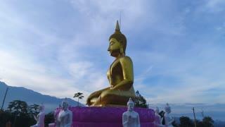 Huge Gold Budda Crane Shot Aerial Drone Statue Towering Mountians Laos Thailand Cinematic