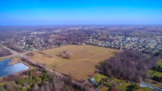 Lansing Michigan Aerial Establishing Shot From Farmers Fields To City Urban Neighborhood Drone Backcountry Country Primitive Flying