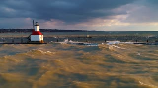 Massive Waves Lighthouse Crashing Over Storm Aerial Drone