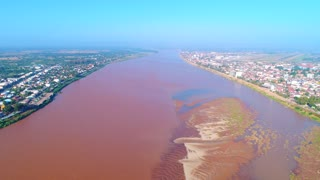 Mekong River Aerial View Drone Footage Pan Up Vientiane Laos Border Of Thailand 4K