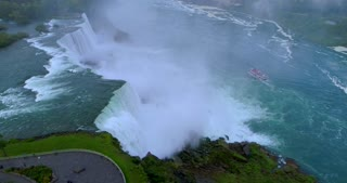 Niagara Falls Maid Of The Mist Tour Boat Aerial Drone Orbit Pan Up Horseshoe Canadian Toronto Canada Skyline Flyover Cinematic Toronto Canada Waterfall River Flight Mist Landmark Usa Tourist Destination 4 K Nature