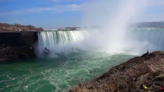 Slow Mo Niagara Falls Water Surging Over Cliff River Splashing Foggy Cloud