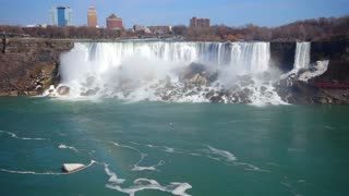Slow Mo Niagara Falls Water Surging Over Cliff River Splashing Rainbow