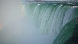 Slow Mo Niagara Falls Water Surging Over Cliff River Splashing Rainbows