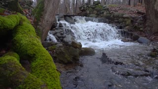 Slow Mo Waterfall Rapids Splashing Over Rocks Mossy Slider Shot
