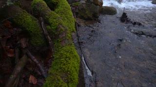 Slow Mo Waterfall Rapids Splashing Over Rocks Mossy Snowing Steadycam Shot Pan Up