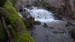 Slow Mo Waterfall Rapids Splashing Over Rocks Mossy Snowing