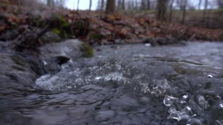 Slow Mo Waterfall Rapids Splashing Over Rocks Snowing