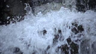 Slow Mo Waterfall Rapids Splashing Over Rocks Tight Shot