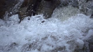 Slow Mo Waterfall Rapids Splashing Over Rocks