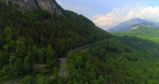 Swiss Alps Aerial Jib Crane Shot Drone Alps Rugged Mountians Push In Countryside Outback Landscape Cliff Evergreen Trees Interlaken Switzerland