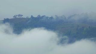 Timelapse Fog Rolls Across Mountain