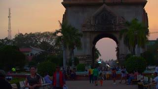 Vientiane Laos Patuxai Arch Imposing 1960s War Memorial Traditional Laotian Carvings Tourist Pan Up 4K Slow Mo