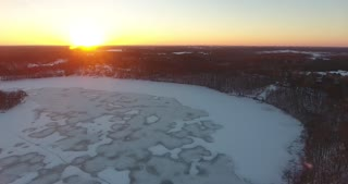 Winter Ice Aerial Flyover Sunset