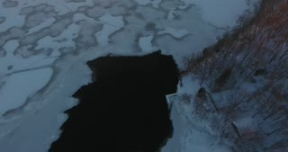 Winter Sunset River Aerial Pan Up