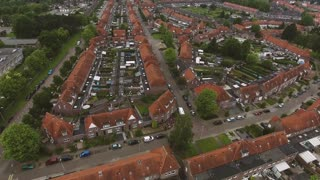 Aerial view of family houses with backyards in residential area of Dutch town