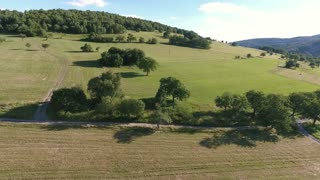 Aerial view of forest and grassland during sunny summer day. Slovakia, Nova Bana.